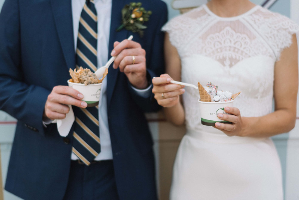 wedding couple with MNice cream cups | food truck | Jonny and Liz Minnesota Wedding Photographers | Sixpence day of coordinating at Gale Woods farm venue near the lake.JPG