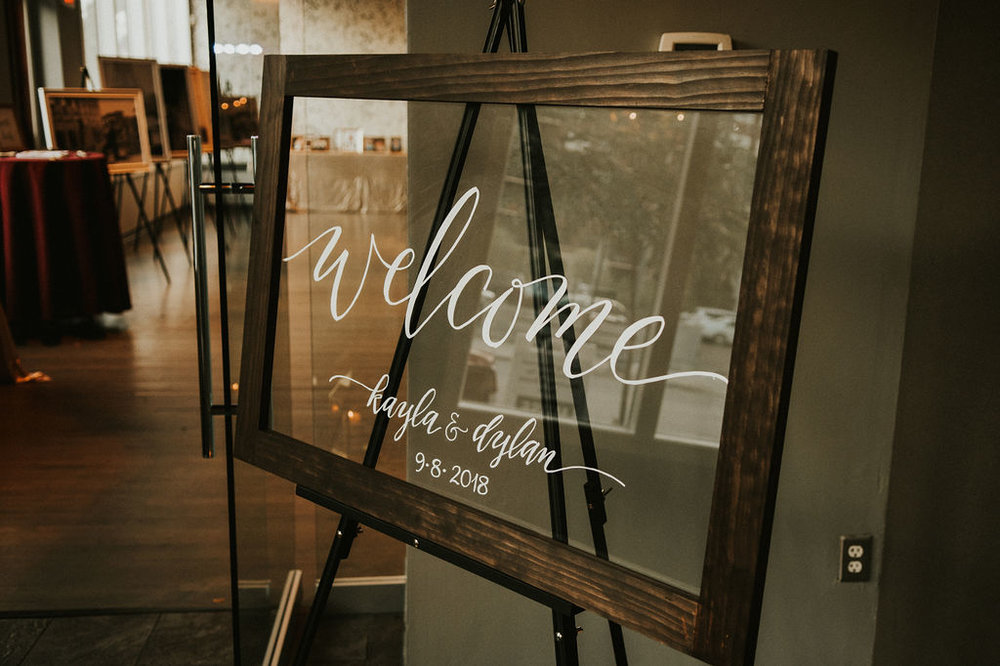 welcome glass framed sign | Roseann Konieczny calligraphy | Asher Marie Photography | Minneapolis day of coordinator | Muse wedding downtown.jpg