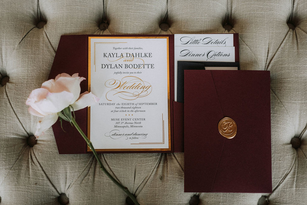 burgundy and gold fold invitation with gold seal | Asher Marie Photography | Minneapolis day of coordinator | Muse wedding downtown.jpg