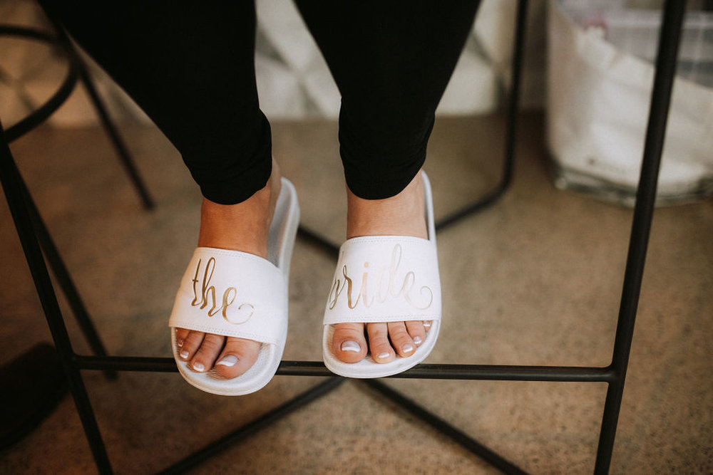 the bride slippers | Asher Marie Photography | Minneapolis day of coordinator | Muse wedding downtown.jpg