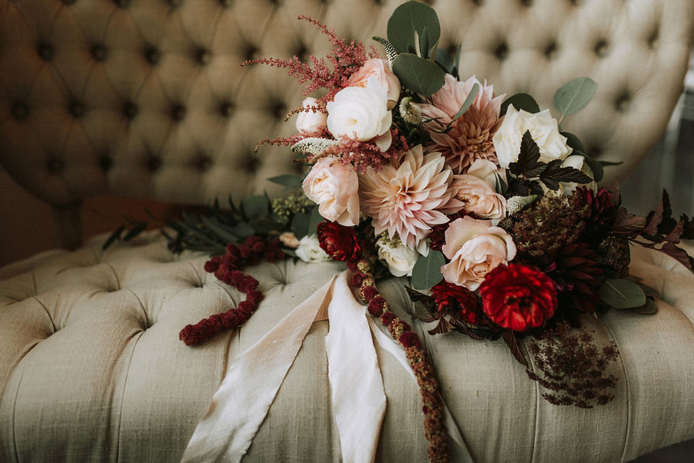 bridal bouquet on tufted settee | Asher Marie Photography | Minneapolis day of coordinator | Muse wedding downtown.jpg