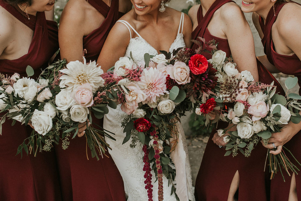 bridesmaids bouquets with large mum blooms bright red and amaranthus | Asher Marie Photography | Minneapolis day of coordinator | Muse wedding downtown.jpg