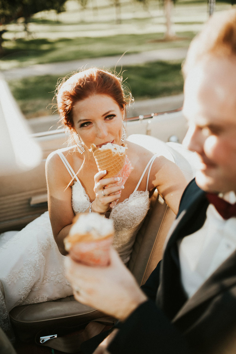 bride and groom ice cream stop during cocktail hour | Asher Marie Photography | Minneapolis day of coordinator | Muse wedding downtown.jpg