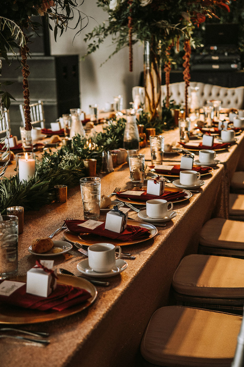 gold table linen sequin with crimson napkins on top of gold chargers for head table | Asher Marie Photography | Minneapolis day of coordinator | Muse wedding downtown.jpg