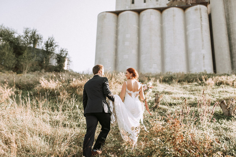 bride and groom on grassy hillside | Asher Marie Photography | Minneapolis day of coordinator | Muse wedding downtown.jpg