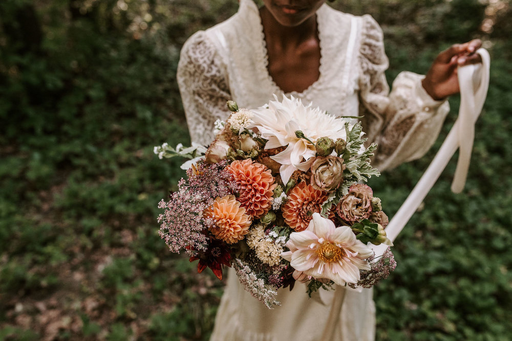 Lady Fern Flowers | local florist in Minneapolis | why you should hire a small florist | bridal bouquet in dusty muted oranges and browns