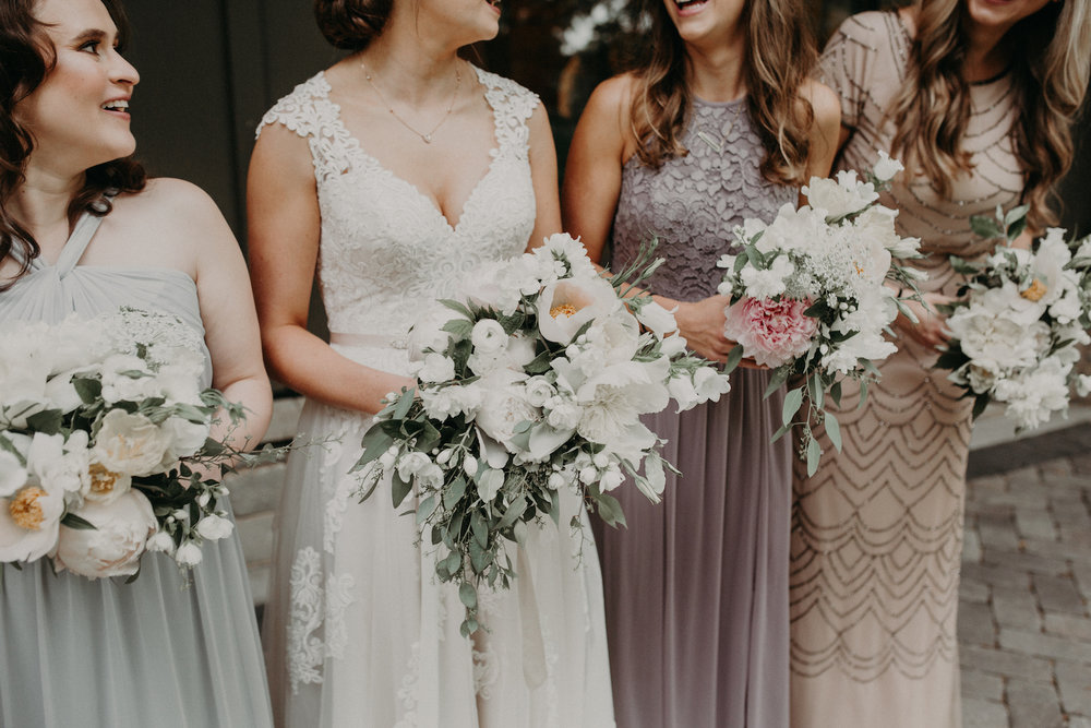 Lady Fern Flowers | local florist in Minneapolis | why you should hire a small florist | bridal bouquet and bridesmaids in whites and pale greens