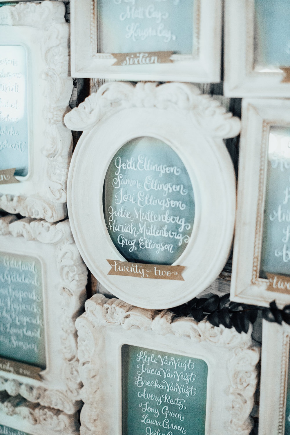 Table seat assignment, white frames and calligraphy | Janelle Elise Photography | Oliver and Grace Design