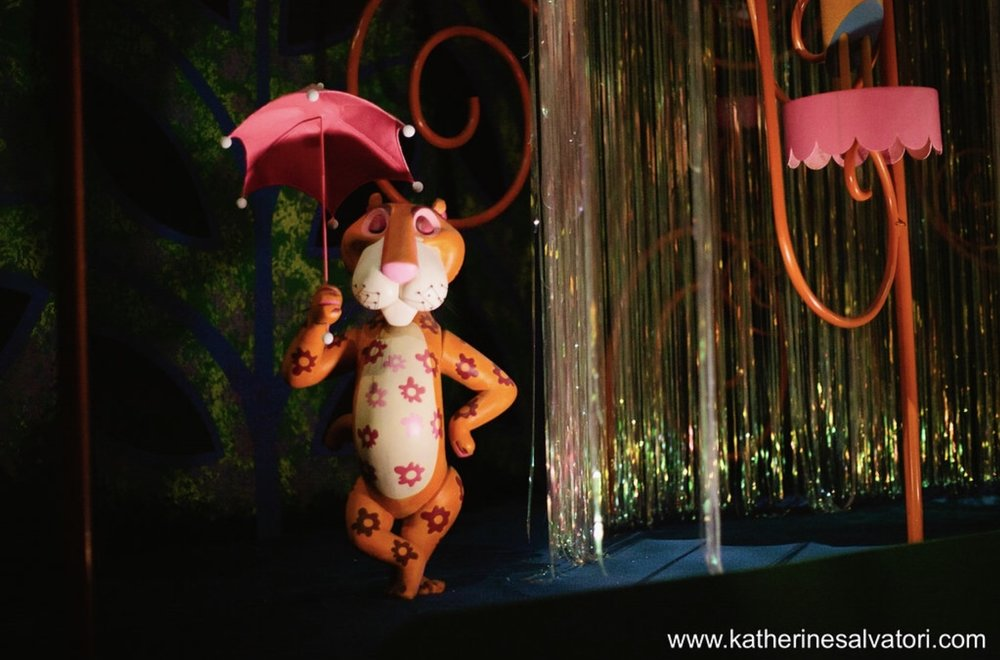 Beautifully captured photo of the Tiger with the umbrella in Magic Kingdom's  It's a Small World