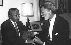 Ron Dellums converses with Nelson Mandela in South Africa.