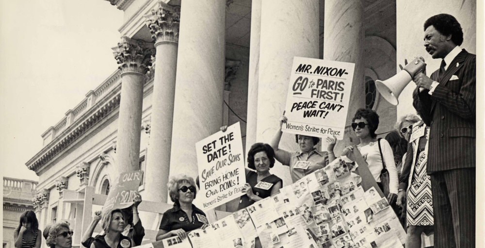 Ron on megaphone with white moms at 1971 Women's Strike for Peace.