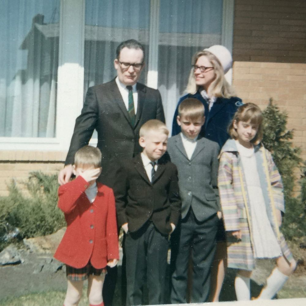 In the backyard of our Calgary home, to which we moved in 1964. My younger brother Scott is shading his eyes, I'm sporting a dapper black jacket and tie, Allan's thinking about quitting Sunday school, and Brenda's posing for a fashion magazine.
