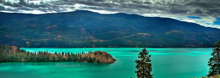 The calcite-rich cyan-to-indigo coloured waters of Lake Kalamalka, B.C. Photo: vernonatriumhotel.ca