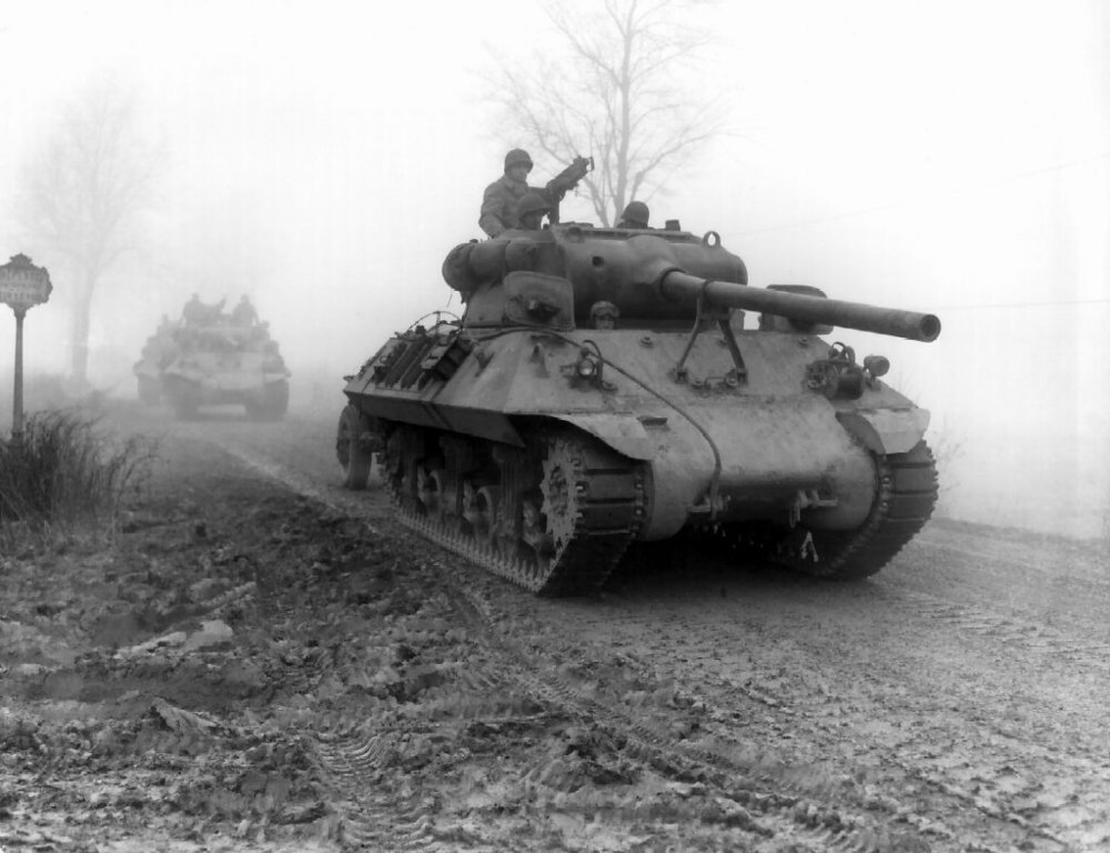 M3 90mm gun -armed American M36 tank destroyers of the 703rd TD, attached to the 82nd Airborne Division, move forward during heavy fog to stem German spearhead near Werbomont, Belgium, 20 December 1944.