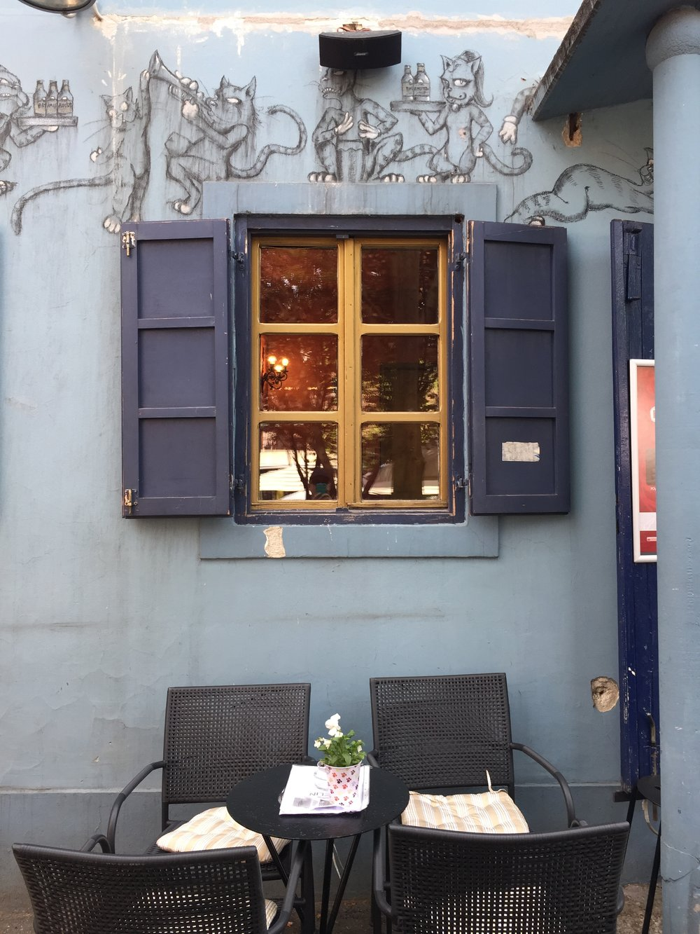 A blue cafe with cats — it reminded me of Bulgakov's  Master & Margarita ...