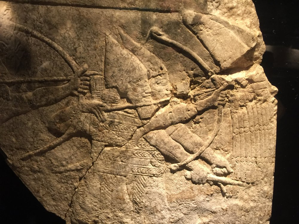 Assyrian archers in battle protected by a reed shield, Nineveh, c. early 7th C. BC.