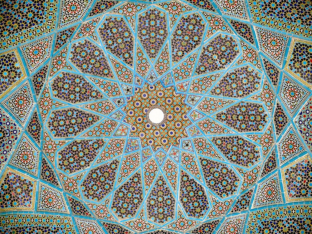 The ceiling of the tomb of the Persian Sufi poet Hafez (1315-1390) in Shiraz (Wikimedia Commons).
