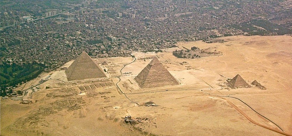 The Giza-pyramids and Giza Necropolis, Egypt, seen from above. Photo taken on 12 December 2008. Auhtor: Robster1983 at English Wikipedia. Photo cropped by RYC.