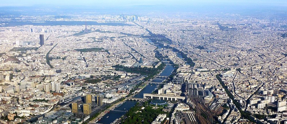 Aerial photograph of Paris, 13 September 2010. Source: Mortimer62. From Wikimedia Commons (cropped — and coloured in the banner above — by RYC)..