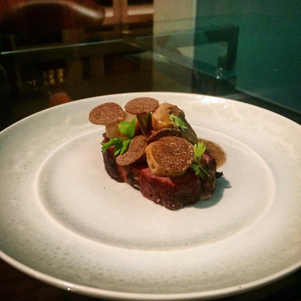 Pork neck, celery root, chestnut, and truffles