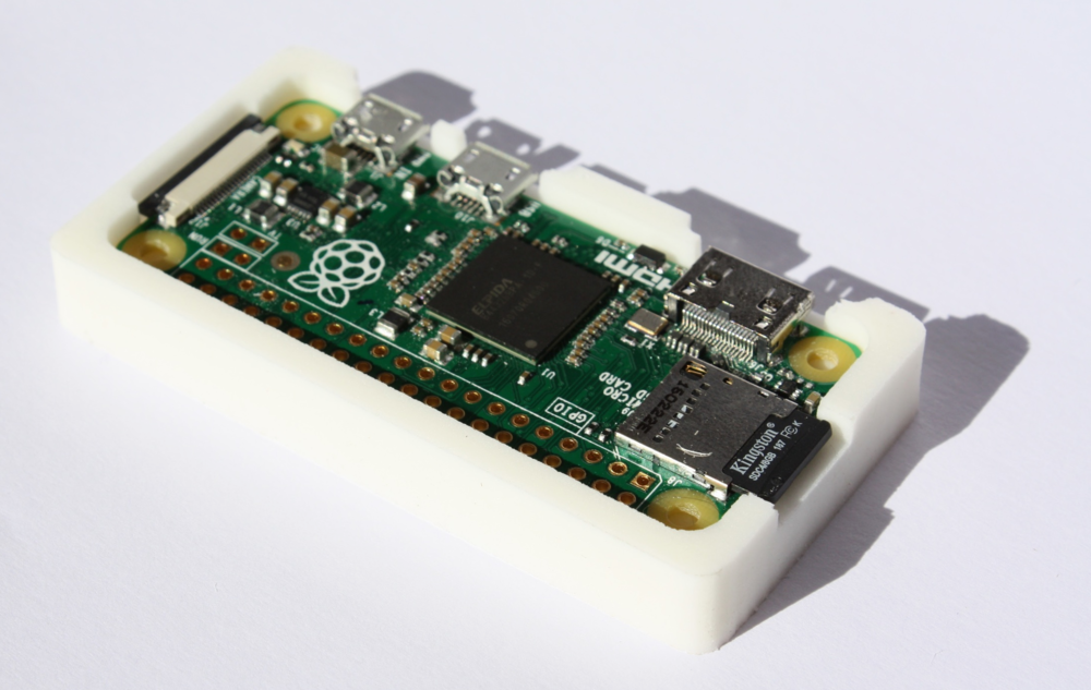 Pi Zero sitting snugly in a custom cast case.