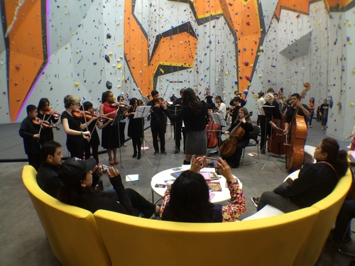 The CPS All-City Orchestra performed for Family Day, led by First Ascent member Rachel Atlas.