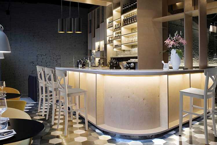 Specialist contract furniture arranged in a modern wooden bar
