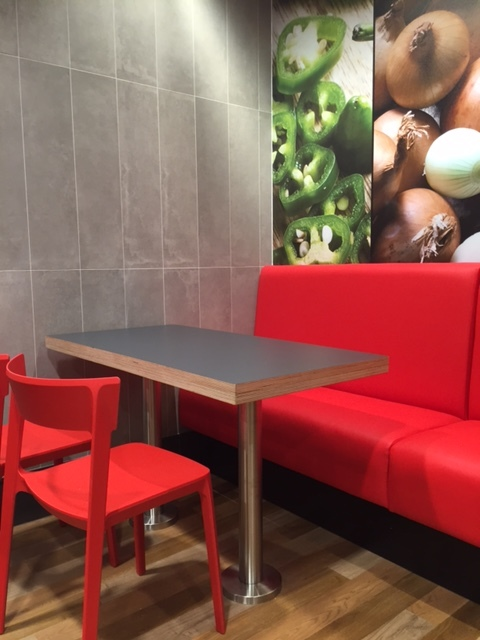 Contract furniture table and cushioned sofa chair in dominoes pizza Scotland