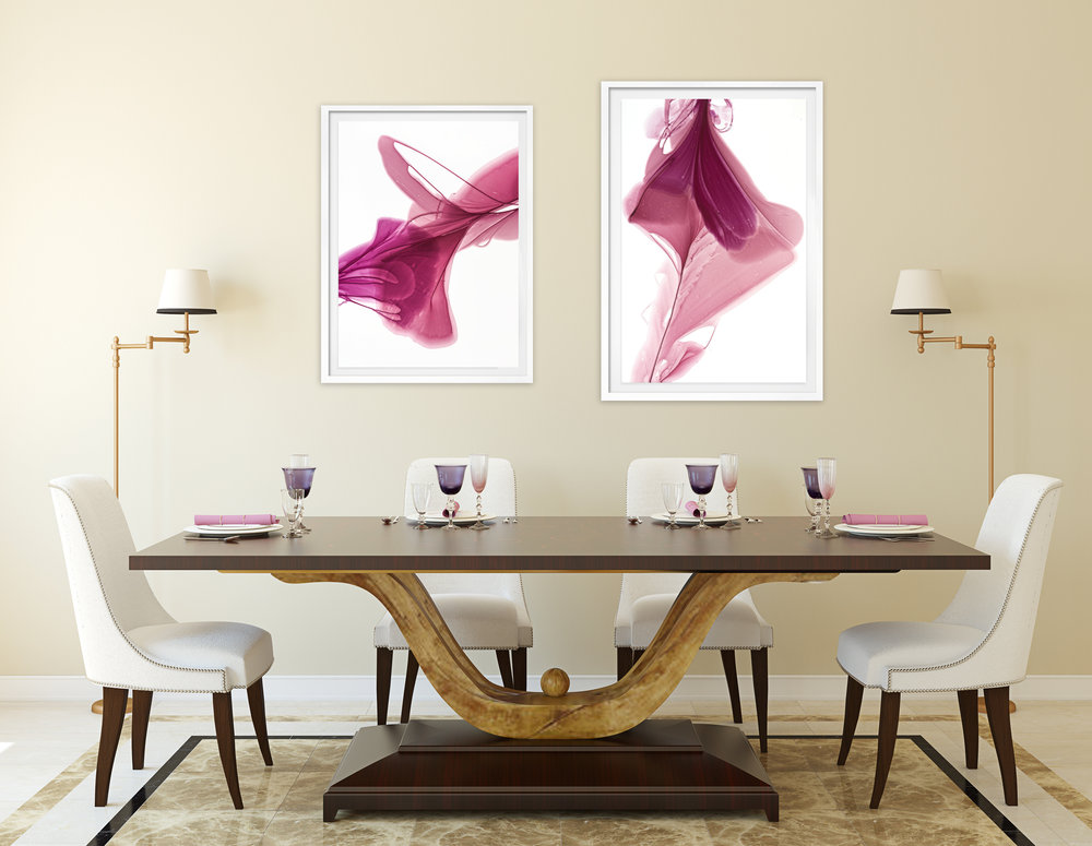 "Don't be afraid to pair different sized pieces on a large wall. Marta Spendowska's ""Rapture of Moments"" and ""Lured by Light"" bring interest to an inviting dining room."
