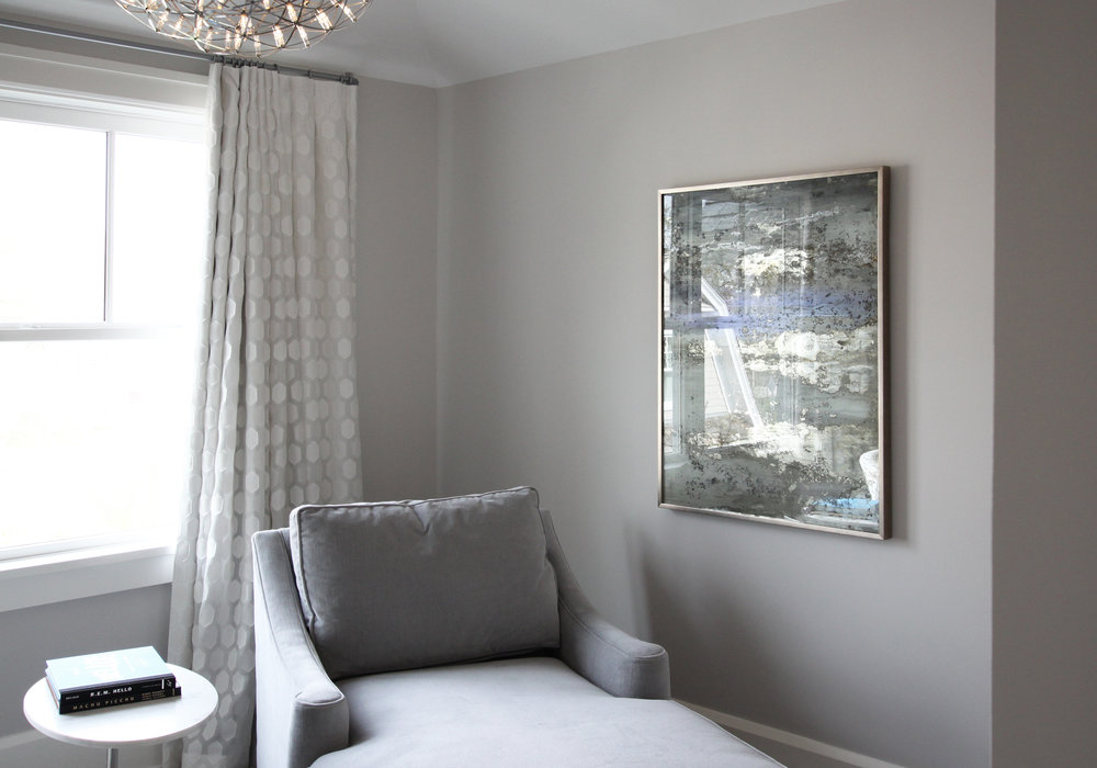 """""""Thou Mayest"""" by Alina B is installed in a serene grey Master Bedroom sitting area."""