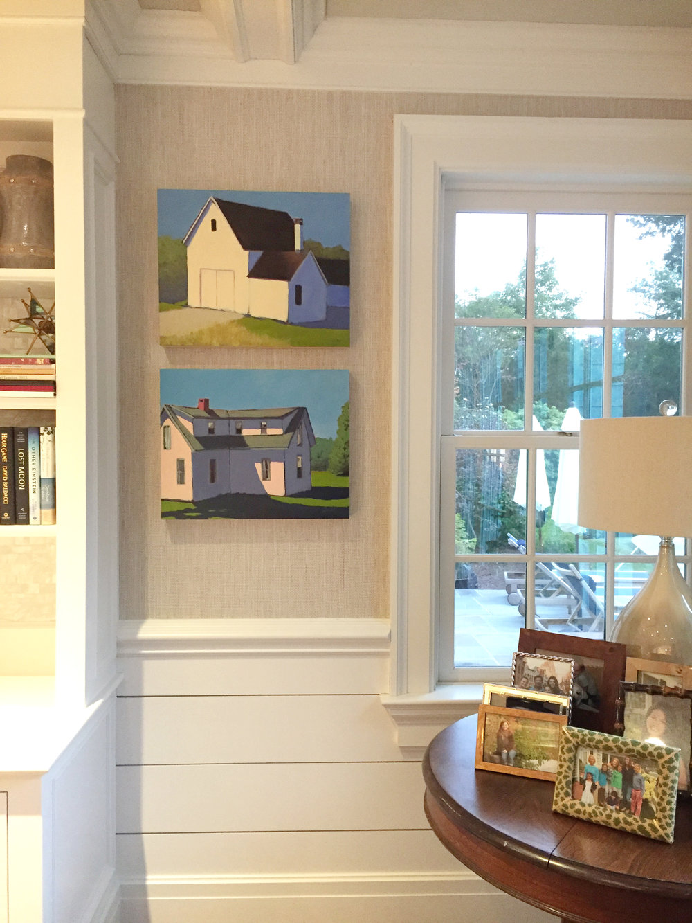 "SOLD: ""Chester Barn"" and ""Serene Shadows"" by Carol C. Young installed in a family room."