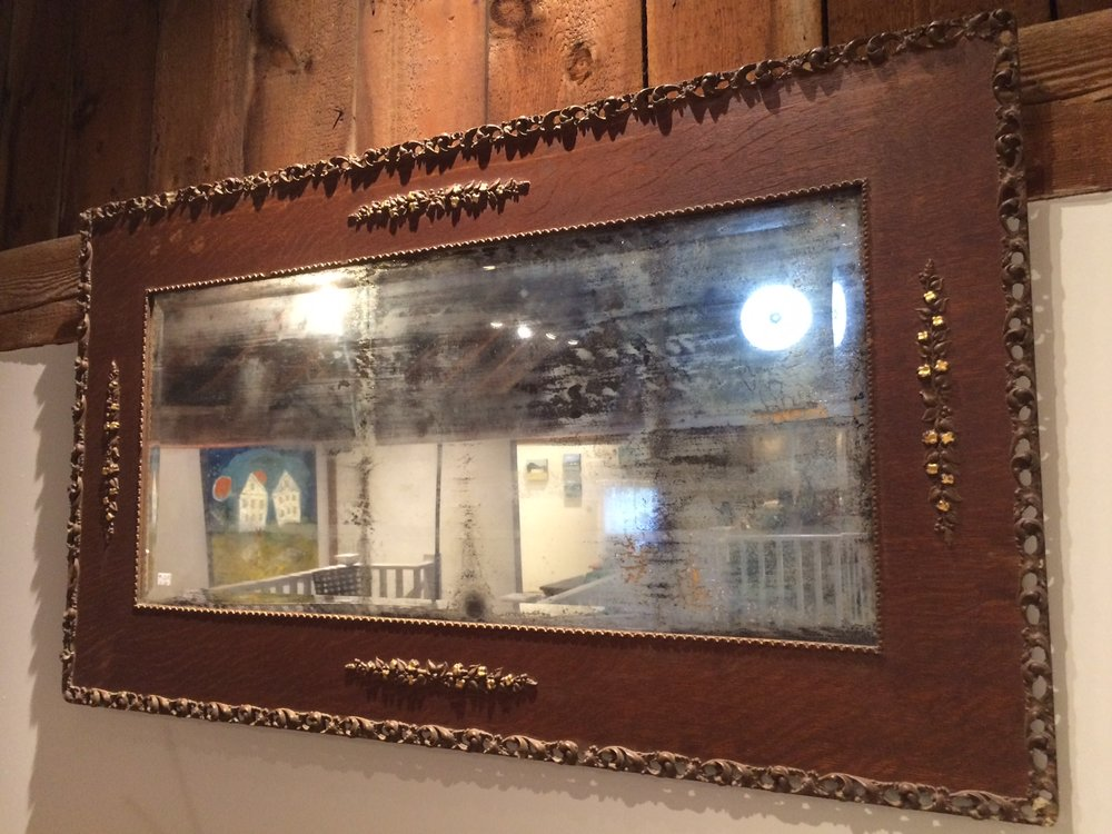 Vintage mirror with ornately decorated frame