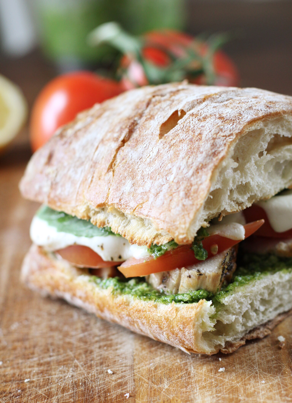 Chicken, tomato, and mozz melt with basil-arugula pesto - The Pastiche