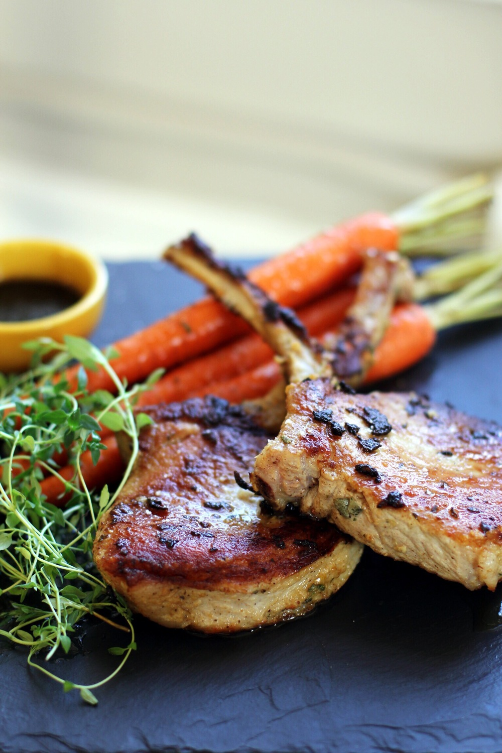 Pan seared pork chops with roasted carrots au ju - The Pastiche