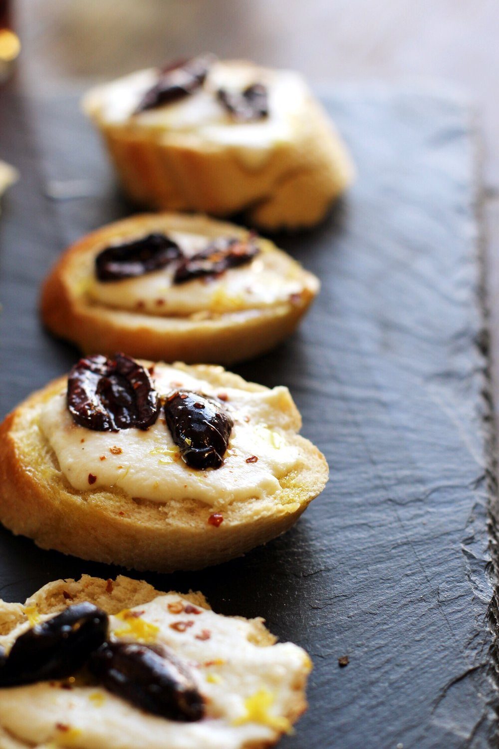 Ricotta toasts with roasted olives and chili oil - The Pastiche