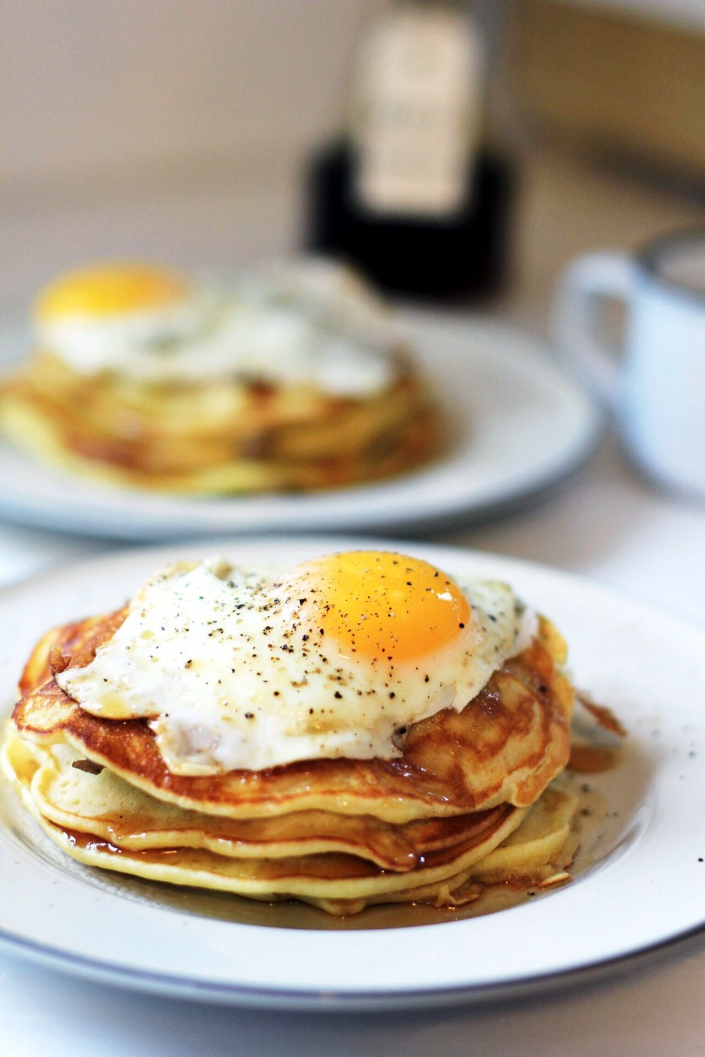 Sausage pancakes with a fried egg and black pepper syrup - The Pastiche