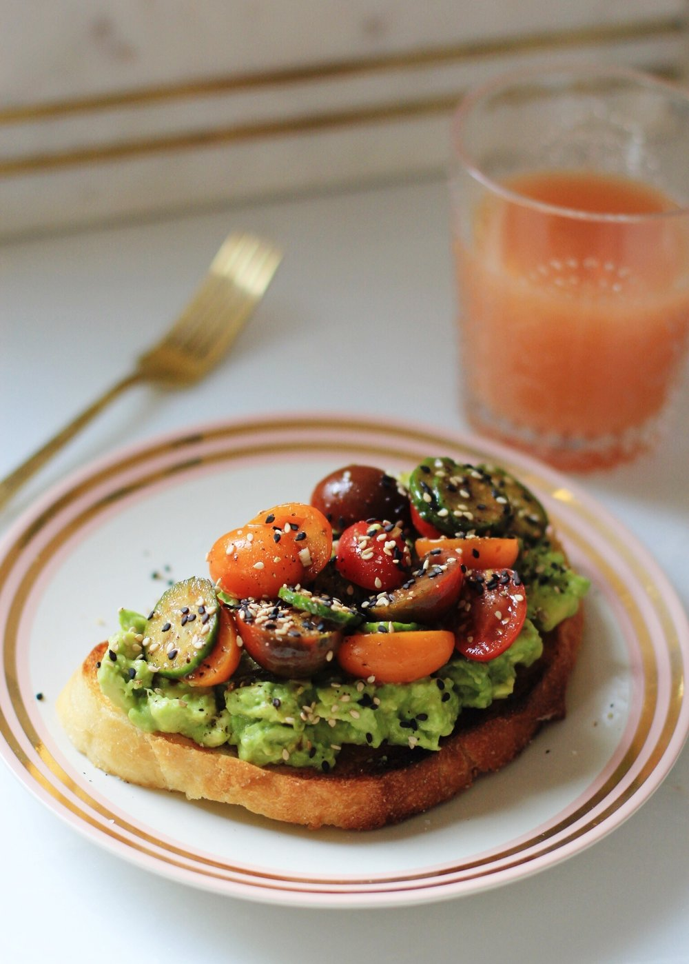 Avocado toast with marinated tomatoes and cucumbers