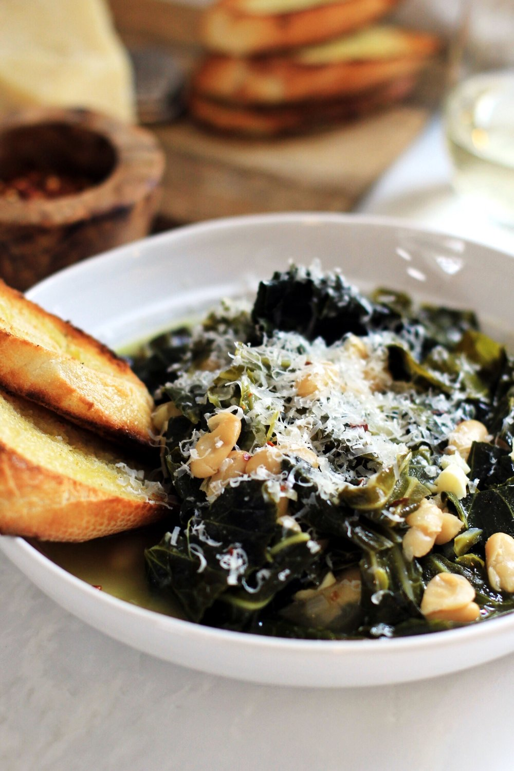 Collard greens and beans in white wine broth
