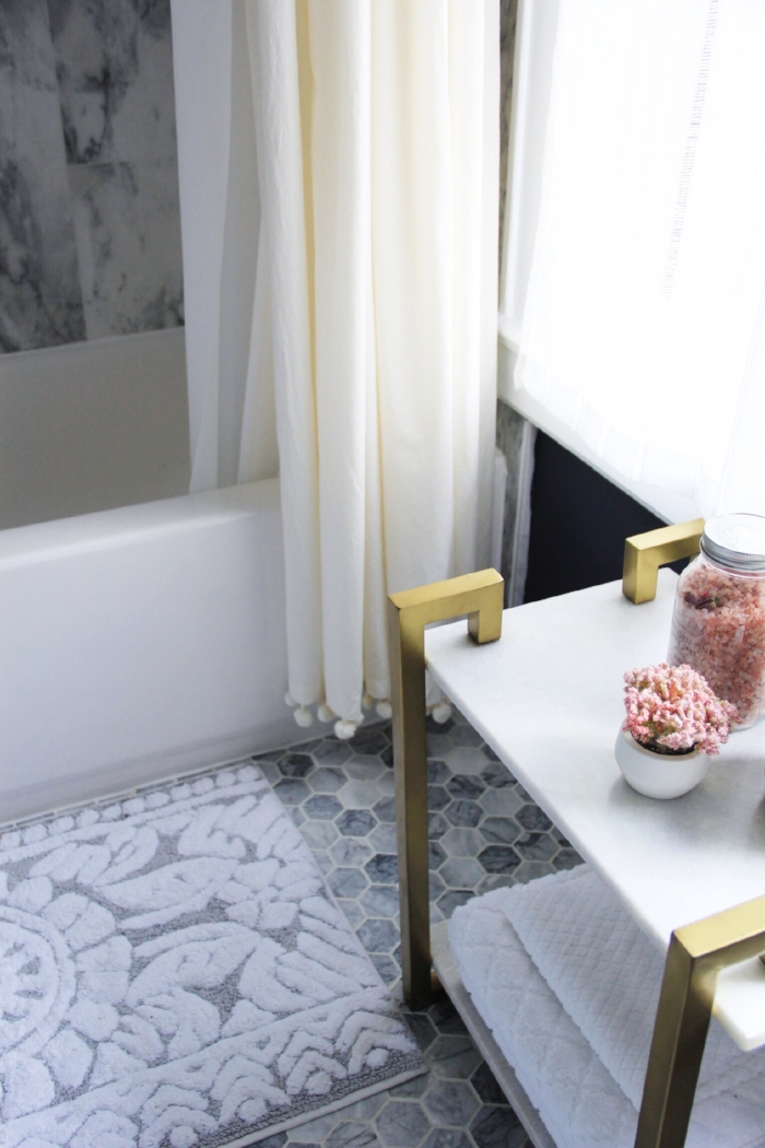 Our navy and brass bathroom