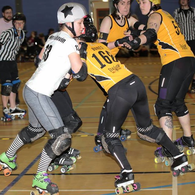 Janie Bones digs deep to stop Baker's Shovin'.  Photo courtesy of John Jamieson, JaJa Photography.