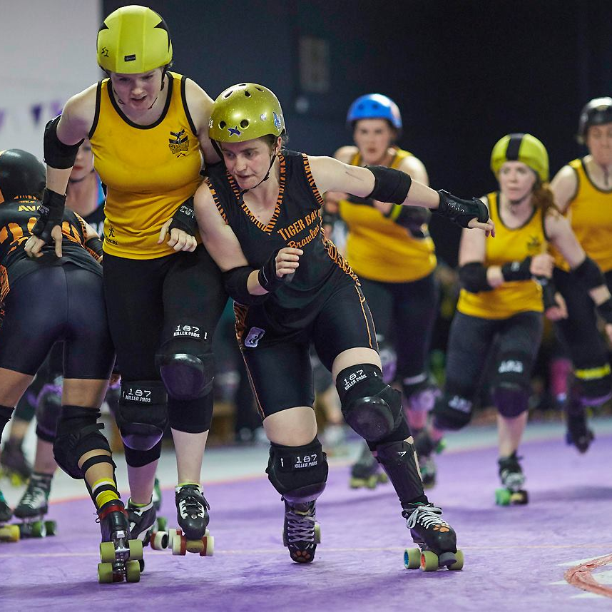 The Maidens' Nikki BlockHer Glory bursting through Tiger Bay B's defenses. Photo courtesy of  Roller Derby On Film.