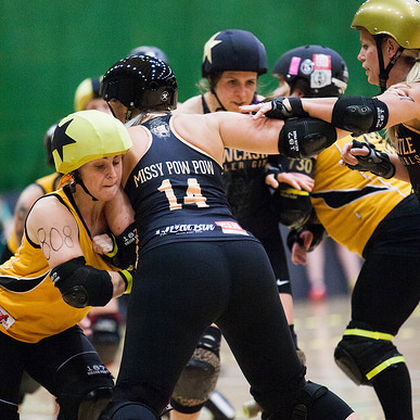 Bruise Missile fighting to get past the fierce defences of Missy Pow Pow; photo courtesy of  Dave Moore .