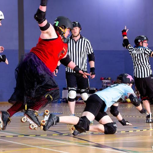 Fever showing Postlewaight her magical flying smashy roller derby powers; photo courtesy of Dave McAleavy boutday.com.