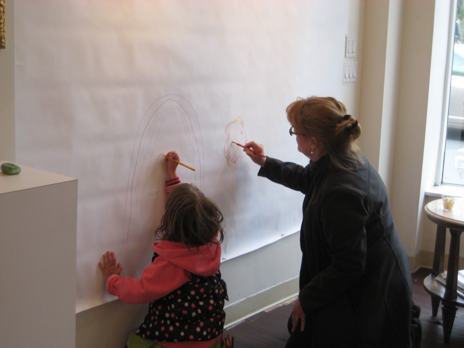 Artist Anne McCaffrey and her daughter start off the Make Art Now wall