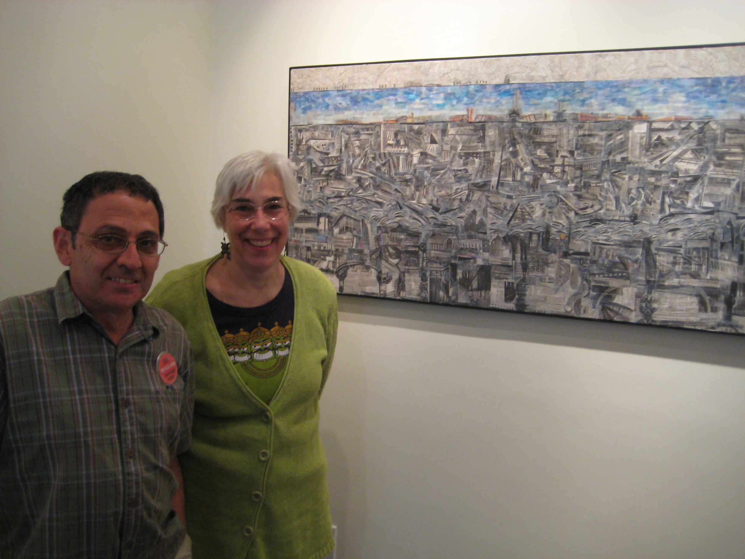 Revolver Artist Mohammed Daoudi and his wife in front of his work