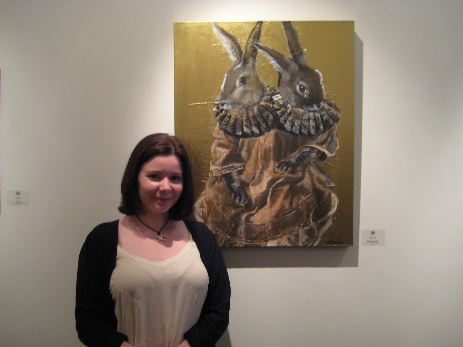 "Side Show Artist Cheryl Polcaro in front of her work, ""Siamese Twins"""
