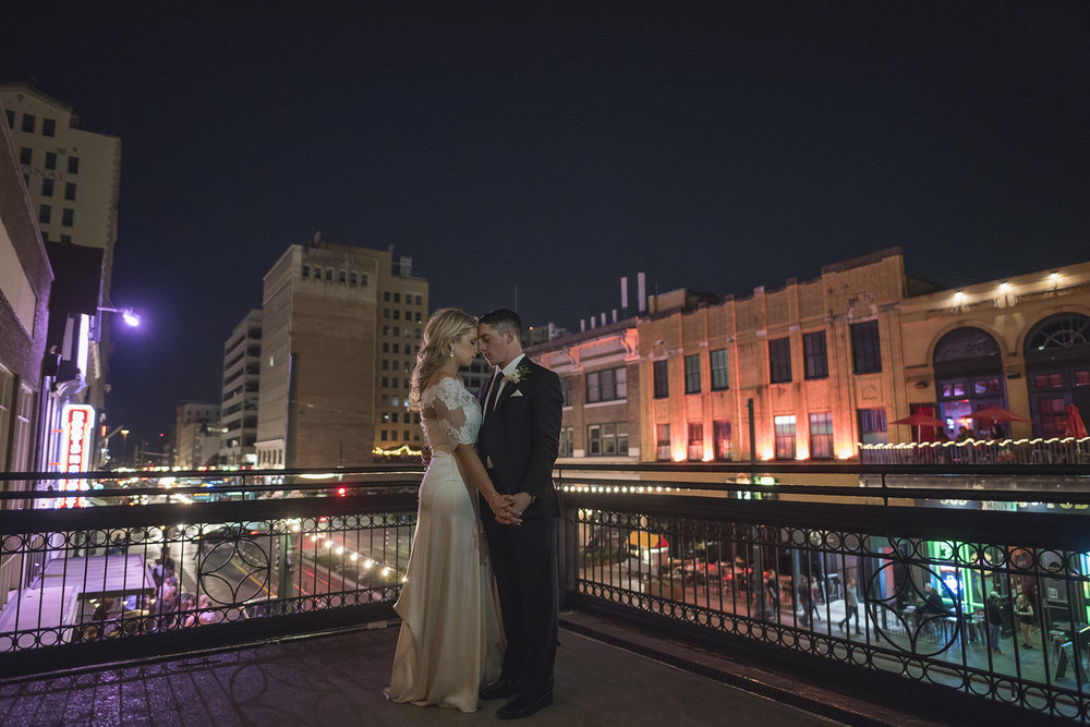 Claire + Travis : I love pulling the couple away from their wedding reception to get a few intimate night portraits. Here at the  Crystal Ballroom at the Rice  the city lights and views of downtown Houston were perfection!