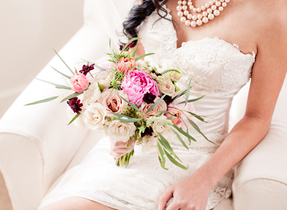 """""""Antiqua"""" bridal satin corset with a beautiful bouquet created by Amy Eimer."""