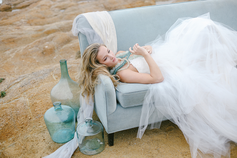 """The perfect combo of seafoam color glass vases and chunky necklaces with our """"Orlando"""" tulle wedding dress."""