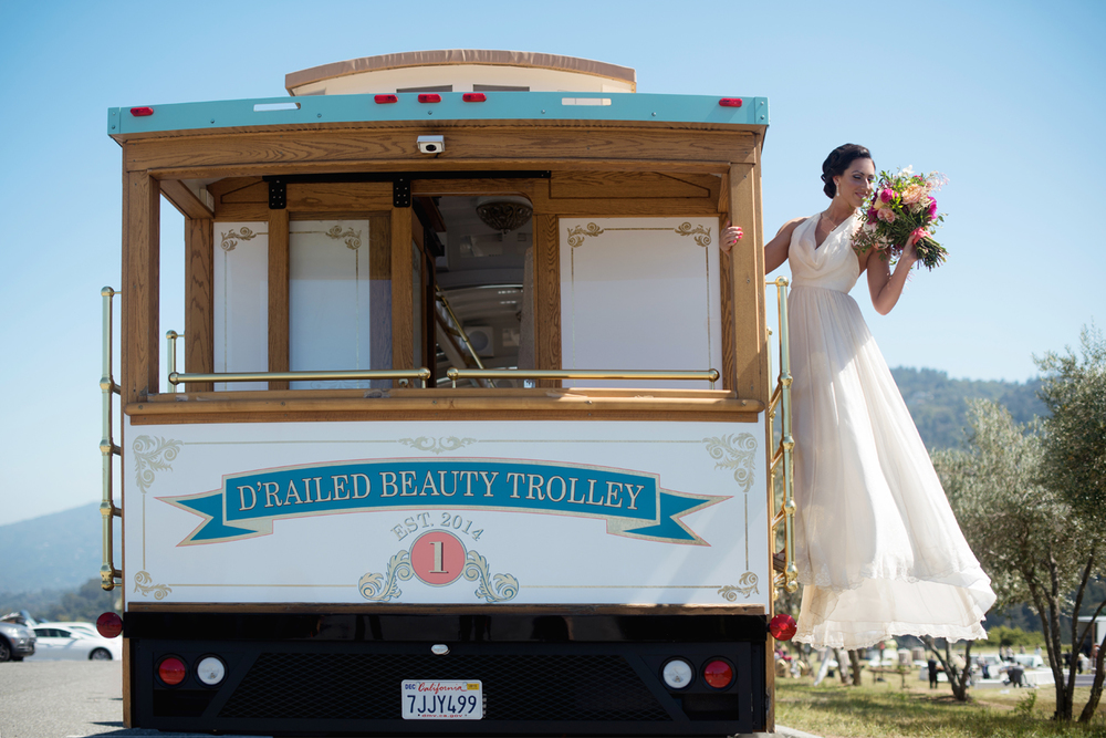 "D'Railed Beauty Trolley based in San Jose, CA adds a fun and interesting vintage vibe. Bride dressed in  Ju.Lee Collection ""Maui"" wedding dress ."